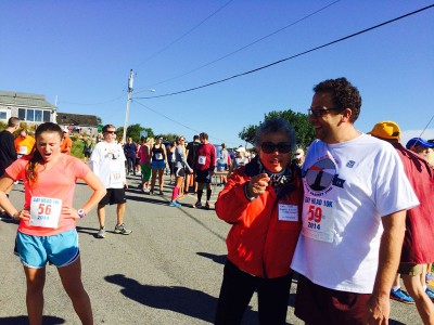 Beverly Wright congratulates Spencer Booker after he ran the 2014 Gay Head 10K