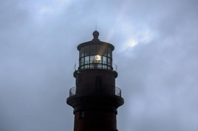 On a rainy day, and despite a brief power outage, the Gay Head Light has resumed its watch over mariners. Maria Thibodeau